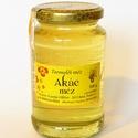 akác méz, nagyon világos, áttetsző, szinte zöldes árnya...